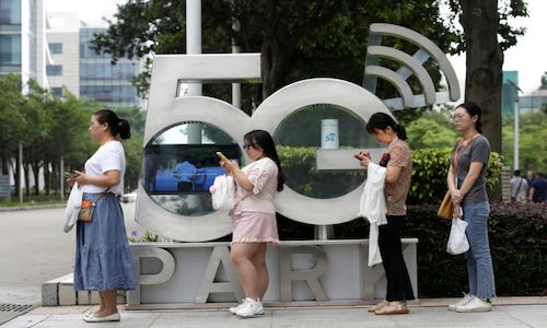 Employees wait for a shuttle bus at a 5G testing park at Huawei's headquarters in Shenzhen, Guangdong province, China.
